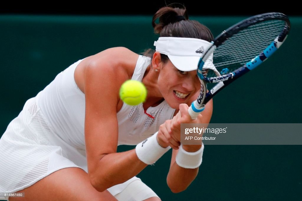 Spain's Garbine Muguruza returns against US player Venus Williams during their women's singles final match on the twelfth day of the 2017 Wimbledon Championships at The All England Lawn Tennis Club in Wimbledon, southwest London, on July 15, 2017. / AFP PHOTO / Adrian DENNIS / RESTRICTED