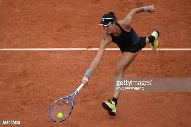 Spain's Garbine Muguruza returns the ball to Russia's Maria Sharapova during their women's singles quarter-final match on day eleven of The Roland...