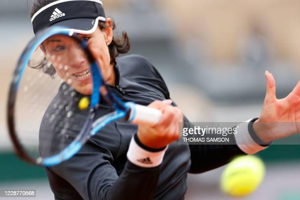 Spain's Garbine Muguruza returns the ball to Slovenia's Tamara Zidansek during their women's singles first round tennis match on Day 2 of The Roland...