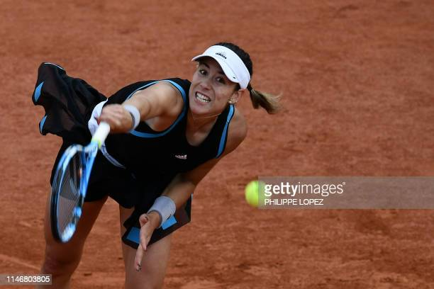 TOPSHOT Spain's Garbine Muguruza returns the ball to Sweden's Johanna Larsson during their women's singles second round match on day four of The...