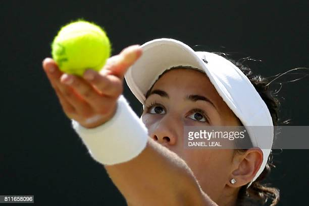Spain's Garbine Muguruza serves against Germany's Angelique Kerber during their women's singles fourth round match on the seventh day of the 2017...