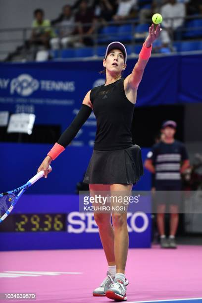 Spain's Garbine Muguruza serves against Switzerland's Belinda Bencic during their women's singles first round match at the Pan Pacific Open tennis...