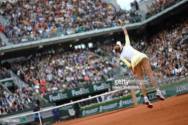 TOPSHOT Spain's Garbine Muguruza serves the ball to US player Serena Williams during their women's final match at the Roland Garros 2016 French...