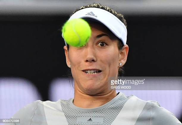 Spain's Garbine Muguruza watches the ball as she plays a backhand return to France's Jessika Ponchet during their women's singles first round match...