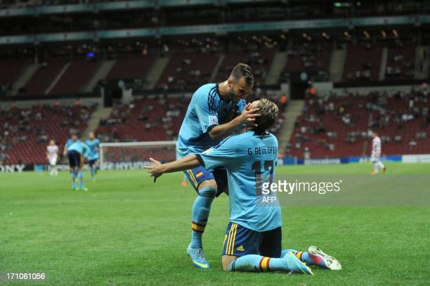 Spain's Gerard Deulofeu celebrates with teammate Jese after scoring a goal during a group stage football match between Spain and the United States at...