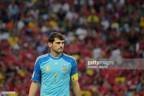 Spain's goalkeeper and captain Iker Casillas looks on during a Group B football match between Spain and Chile in the Maracana Stadium in Rio de...