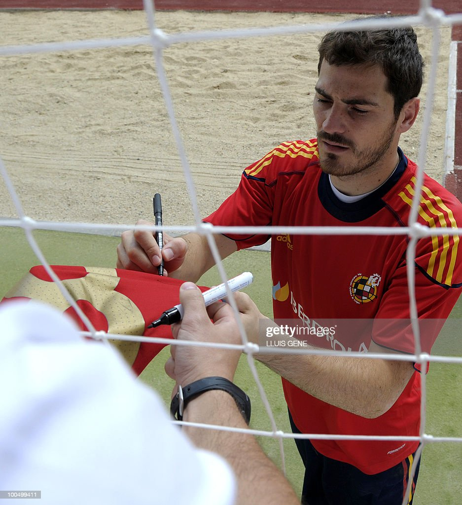 Spain's goalkeeper and captain Iker Casillas signs autographs after a training session of the Spanish football team on May 25, 2010, at the Sports City of Las Rozas, near Madrid. Spain, among the favourites for the World Cup, which runs from June 11-July 11, face Switzerland, Honduras and Chile in Group H of the opening round.