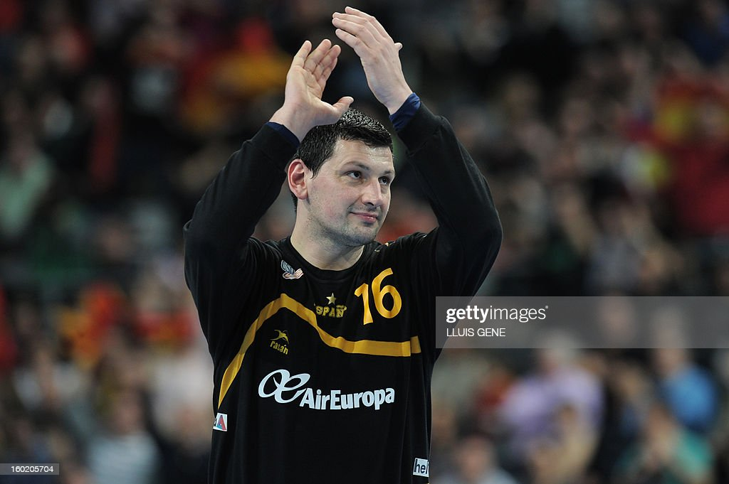 Spain's goalkeeper Arpad Sterbik applauds during the 23rd Men's Handball World Championships final match Spain vs Denmark at the Palau Sant Jordi in Barcelona on January 27, 2013.