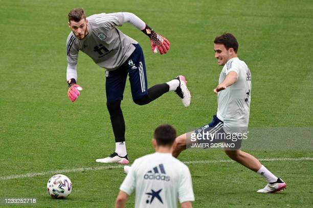 Spain's goalkeeper David De Gea and Spain's defender Eric Garcia attend a training session at the Wanda Metropolitano stadium in Madrid on June 3,...