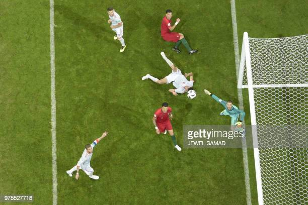 Spain's goalkeeper David De Gea and Spain's defender Sergio Ramos watch the ball during the Russia 2018 World Cup Group B football match between...