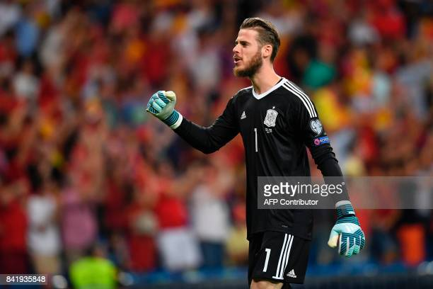 Spain's goalkeeper David de Gea celebrates after Spain scored the opener during the World Cup 2018 qualifier football match Spain vs Italy at the...
