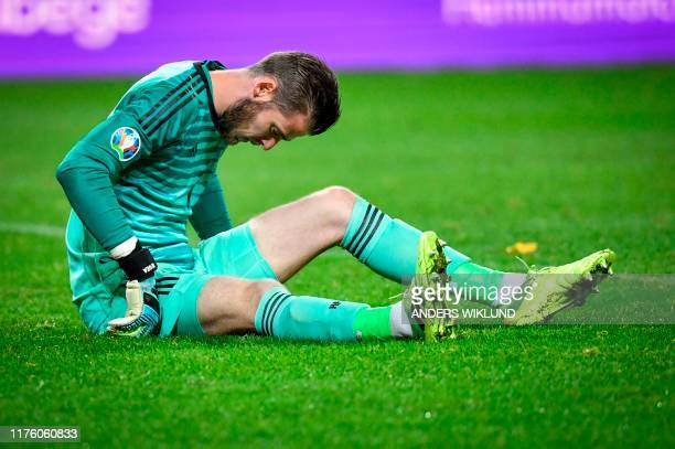 Spain's goalkeeper David de Gea is injured during the UEFA Euro 2020 Group F qualification football match Sweden v Spain in Solna Sweden on October...