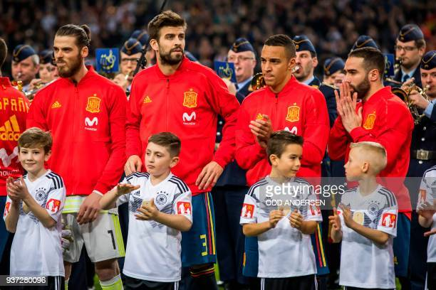 Spain's goalkeeper David de Gea Spain's defender Gerard Pique Spain's forward Rodrigo Moreno and Spain's defender Dani Carvajal line up for the...