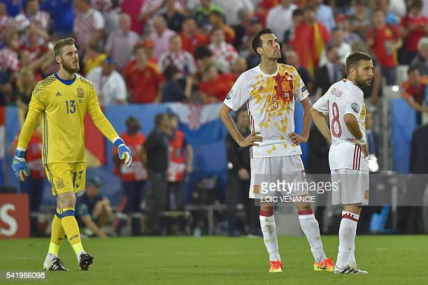 Spain's goalkeeper David De Gea Spain's midfielder Sergio Busquets and Spain's defender Jordi Alba react following their loss during the Euro 2016...