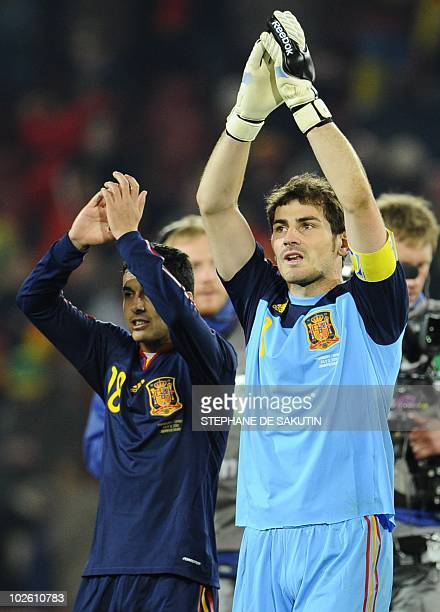 Spain's goalkeeper Iker Casillas and Spain's striker Pedro applaud supporters after they won the 2010 World Cup quarterfinal football match Paraguay...