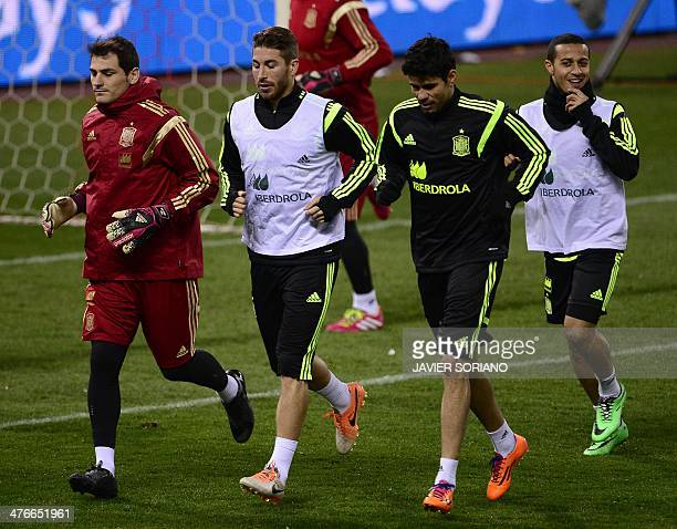 Spain's goalkeeper Iker Casillas chats with Spain's defender Sergio Ramos and Spain's Brazilianborn forward Diego Costa during a training session at...