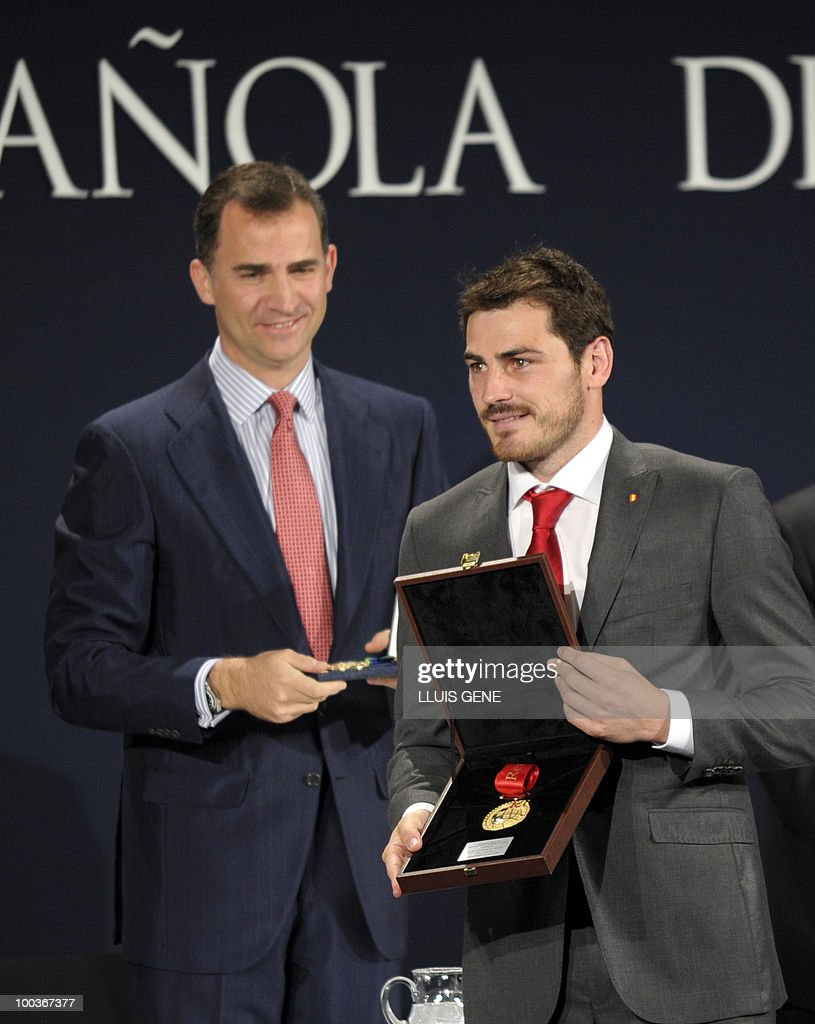 Spain's goalkeeper Iker Casillas (R) holds his Gold Medal for Sports Merit next to Spain's Prince Felipe (L) the inauguration of RFEF museum on May 24, 2010 at the Sports City of Las Rozas, near Madrid. Spain, among the favourites for the World Cup, which runs from June 11-July 11, face Switzerland, Honduras and Chile in Group H of the opening round.