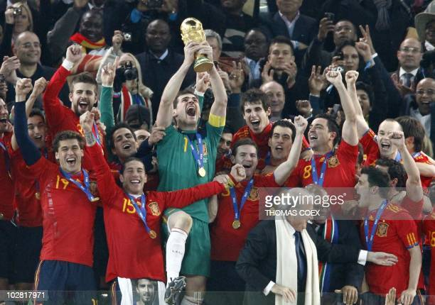Spain's goalkeeper Iker Casillas holds the trophy during the award ceremony following the 2010 FIFA football World Cup between the Netherlands and...