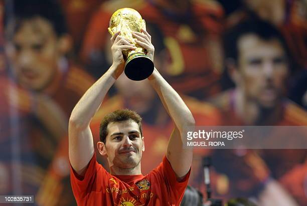 Spain's goalkeeper Iker Casillas holds up the trophy on a stage set up for the Spanish team victory ceremony in Madrid on July 12 2010 a day after...