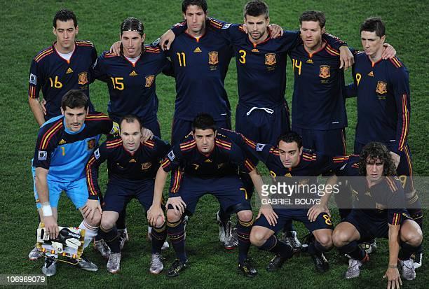 Spain's goalkeeper Iker Casillas Spain's midfielder Andrés Iniesta Spain's striker David Villa Spain's midfielder Xavi and Spain's defender Carles...
