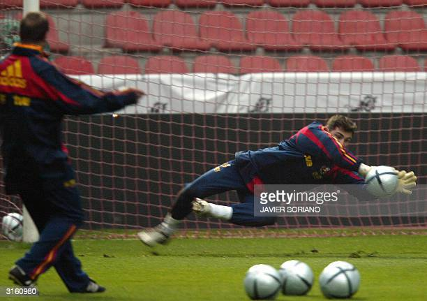 Spain's goalkeeper Iker Casillas stops a ball during a training session, 30 March 2004, at Molinon Stadium in Gijon, northern Spain, on the eve of...