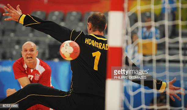 Spain's goalkeeper Jose Javier Hombrados fails to catch a shot by Croatia's Goran Sprem during the men's handball bronze medal match of the 2008...
