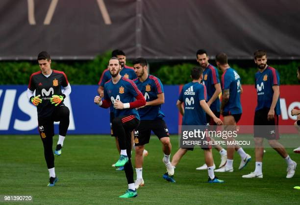 Spain's goalkeeper Kepa Arrizabalaga Revuelta and Spain's goalkeeper David De Gea attend a training session at Krasnodar Academy on June 22 during...