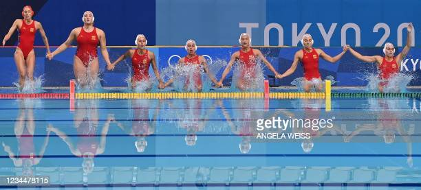 Spain's goalkeeper Laura Ester Ramos and her teammates jump in to the water ahead of the Tokyo 2020 Olympic Games women's water polo semi-final match...