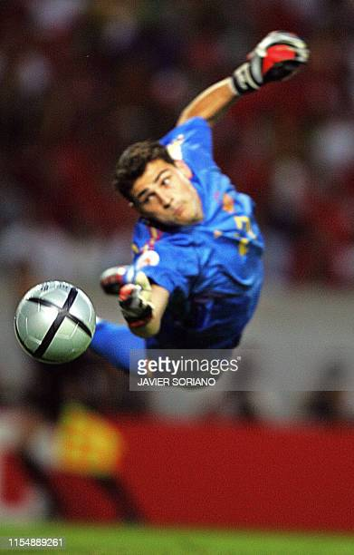 Spain's goalkeeper Spain's goalkeeper Iker Casillas looks at the ball kicked by Portugal's forward Nuno Gomes 20 June 2004 at Jose Alvalade stadium...