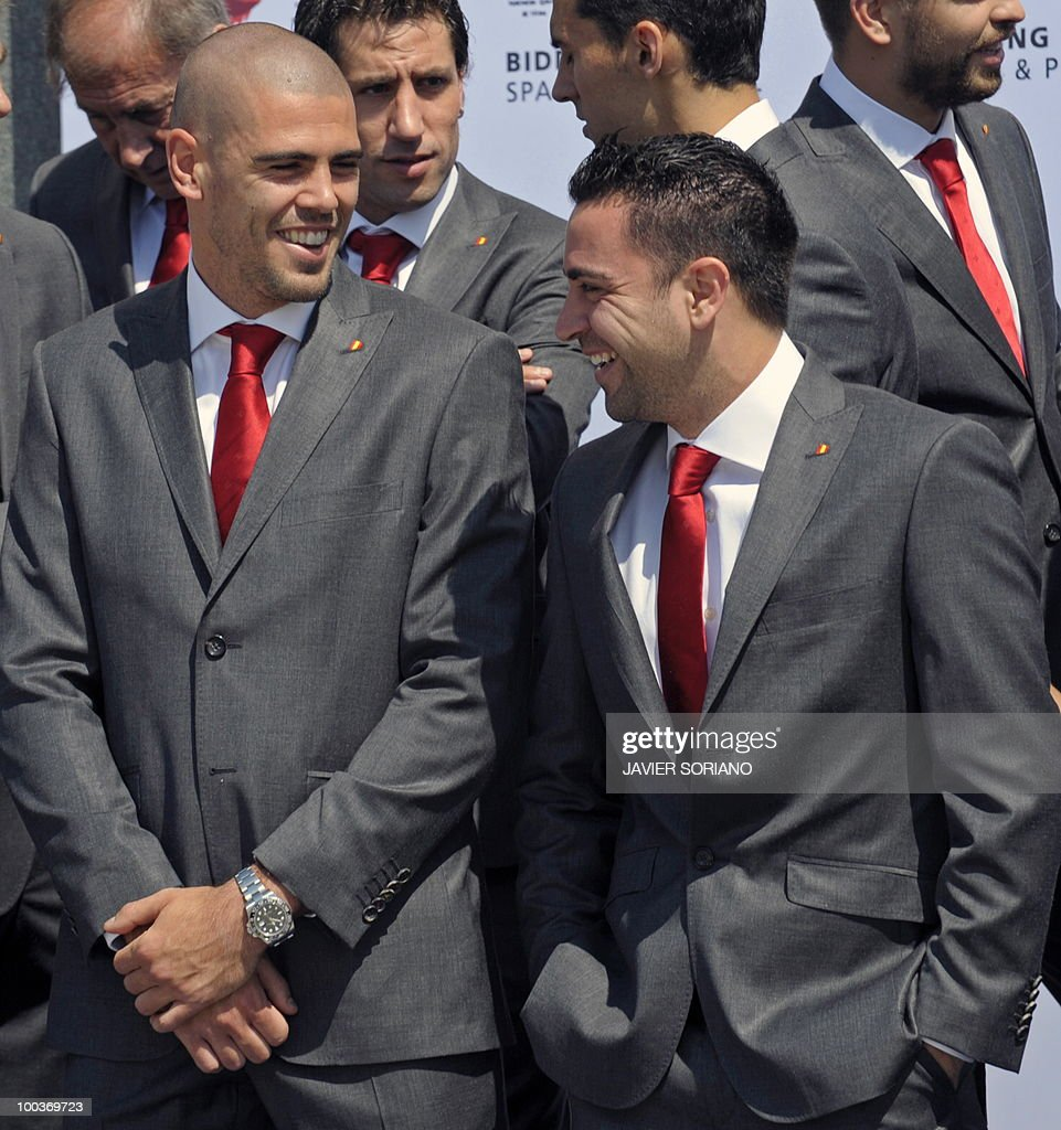 Spain's goalkeeper Victor Valdes (L) chats with midfielder Xavi Hernandez (R) before taking a group picture during the inauguration of Spanish Football Team museum on May 24, 2010 at the Sports City of Las Rozas, near Madrid. Spain, among the favourites for the World Cup, which runs from June 11-July 11, face Switzerland, Honduras and Chile in Group H of the opening round.