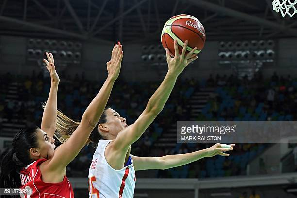 TOPSHOT Spain's guard Anna Cruz goes to the basket past Serbia's shooting guard Ana Dabovic during a Women's semifinal basketball match between Spain...