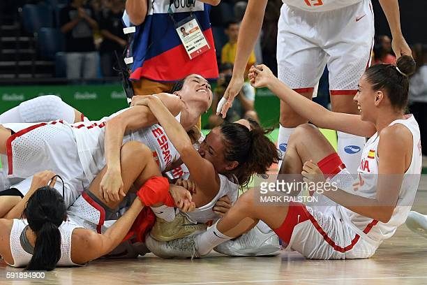 Spain's guard Anna Cruz Spain's point guard Laia Palau and Spain's forward Laura Quevedo celebrate defeating Serbia during a Women's semifinal...