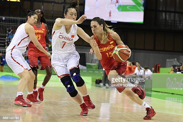Spain's guard Anna Cruz tries to pass China's small forward Shao Ting during a Women's round Group B basketball match between China and Spain at the...