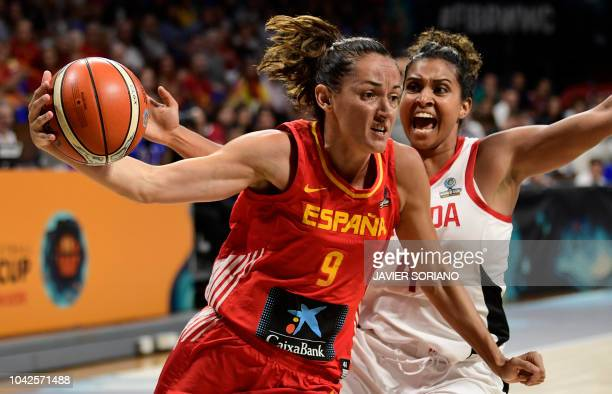 Spain's guard Laila Palau vies with Canada's guard Miah-Marie Langlois during the FIBA 2018 Women's Basketball World Cup quarter final match between...