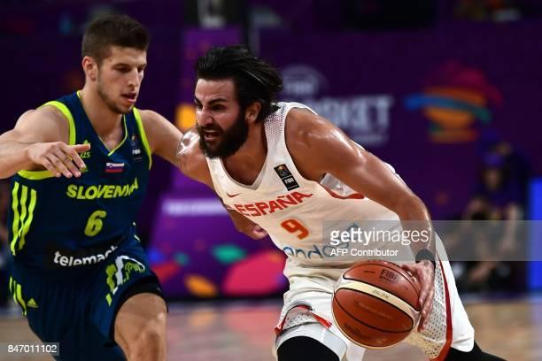 Spain's guard Ricky Rubio vies for the ball with Slovenia's guard Aleksei Nikolic during the FIBA Eurobasket 2017 men's semifinal basketball match...