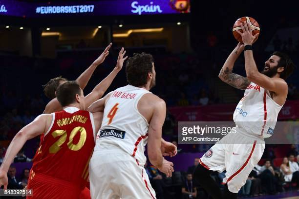 TOPSHOT Spain's guard Ricky Rubio vies with Russia's forward Andrey Vorontsevich during the FIBA Euro basket 2017 men's third game match between...