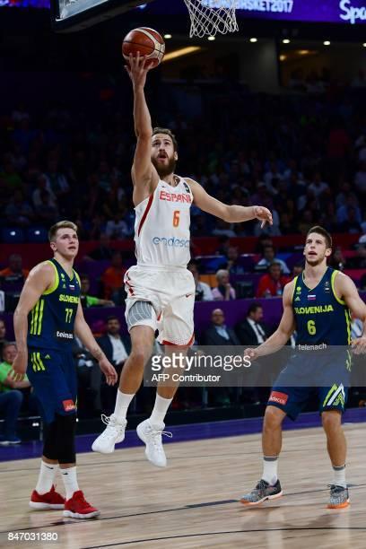 Spain's guard Sergio Rodriguez goes to basket next to Slovenia's guard Luka Doncic and Aleksei Nikolic during the FIBA Eurobasket 2017 men's...