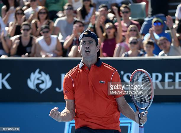 Spain's Guillermo Garcia-Lopez celebrates after victory in his men's singles match against Canada's Vasek Pospisil on day six of the 2015 Australian...