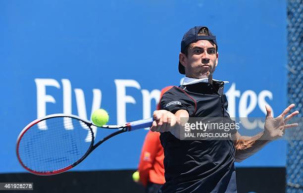 Spain's Guillermo Garcia-Lopez plays a shot during his men's singles match against Colombia's Alejandro Gonzalez on day four of the 2015 Australian...