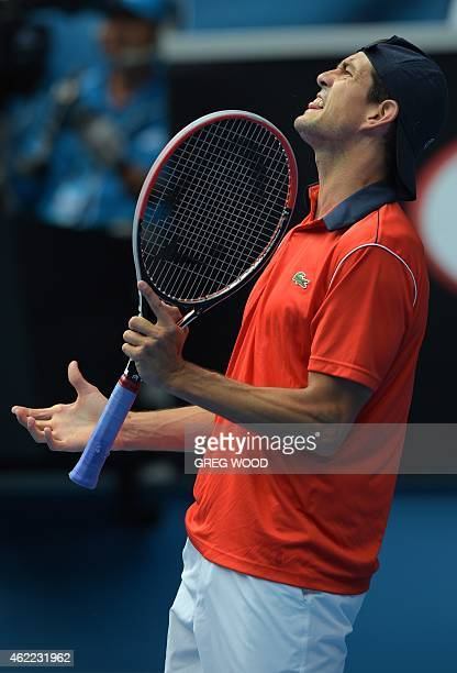 Spain's Guillermo Garcia-Lopez shouts during his men's singles match against Switzerland's Stanislas Wawrinka on day eight of the 2015 Australian...