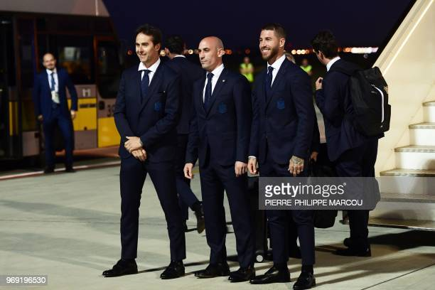 Spain's head coach Julen Lopetegui president of the Spanish football federation Luis Rubiales and Spain's captain and defender Sergio Ramos pose...