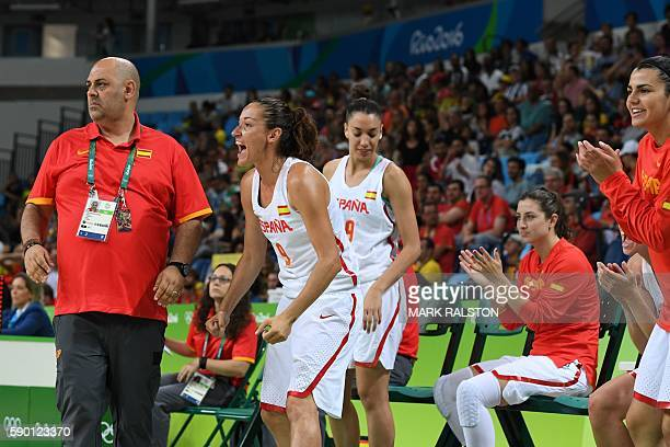 Spain's head coach Lucas Mondelo and Spain's point guard Laia Palau react during a Women's quarterfinal basketball match between Spain and Turkey at...
