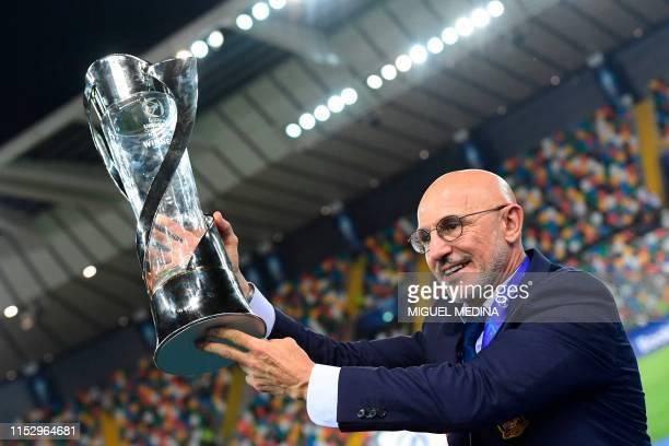 Spain's head coach Luis de la Fuente holds the winners' trophy after Spain won the final match of the UEFA U21 European Football Championships Spain...
