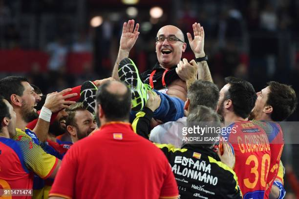 Spain's headcoach Jordi Ribera is being thrown in the air by his players after Spain won the final match of the Men's 2018 EHF European Handball...
