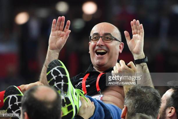 TOPSHOT Spain's headcoach Jordi Ribera is being thrown in the air by his players after Spain won the final match of the Men's 2018 EHF European...