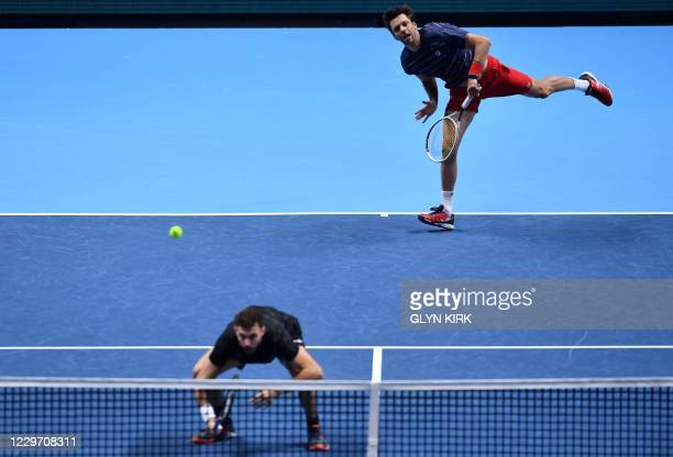 Spain's Horacio Zeballos serves while playing with Spain's Marcel Granollers against Netherlands' Wesley Koolhof and Croatia's Nikola Mektic in their...