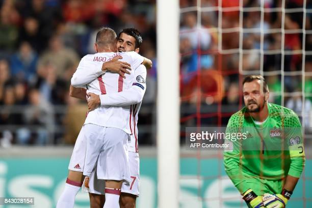 Spain's Iago Aspas celebrates with teammate Alvaro Morata after scoring a goal to Liechtenstein's goalkeeper Peter Jehle during the FIFA World Cup...