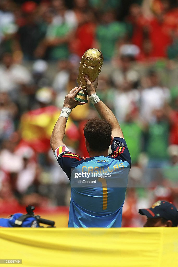 Spain's Iker Casillas raises the FIFA World Cup before an International Friendly Match against Mexico at Azteca stadium on August 11, 2010 in Mexico City.