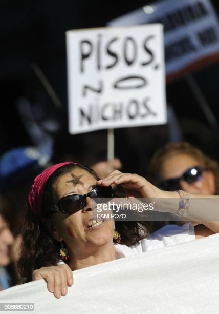 Spain's 'indignant' protesters take part in a demonstration at Plaza de Cibeles to demand solutions of mortgages in Spain on September 25 2011 AFP...