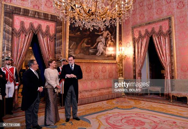 Spain's Interior Minister Juan Ignacio Zoido Spanish Prime Minister Mariano Rajoy and Spain's Defence Minister Maria Dolores de Cospedal wait for the...